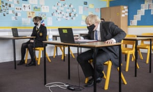 Boris Johnson taking part in an online class, during a visit to Sedgehill School in Lewisham, south east London, this morning.