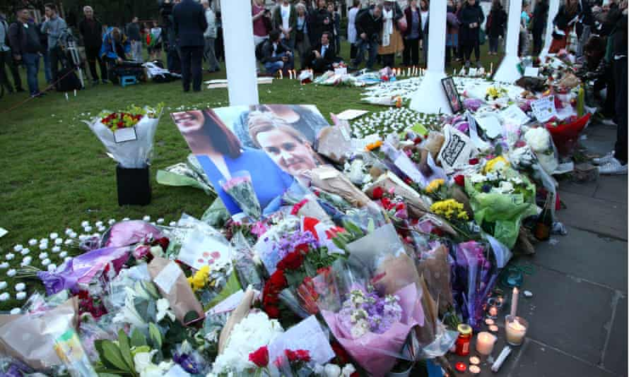 People and politicians gathered in Parliament Square stand in two minutes' silence on Friday evening.
