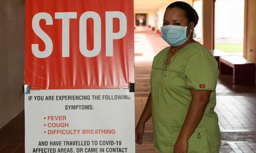 Reinalda Ebiklou at the entrance to Belau National Hospital, the only hospital in the Pacific nation of Palau, which has recorded no cases of coronavirus.