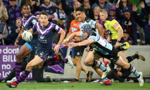 Billy Slater heads for a try