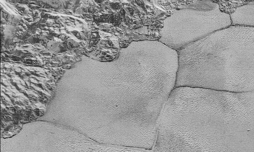 Sputnik Planum, a sea of frozen nitrogen near the Pluto's equator, proved to be patterned by polygonal shapes, as seen in this image form the New Horizons mission.
