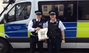 Steve Whitmore (left), with his colleague Sgt Freeman, delivering books to one of the participating police stations.