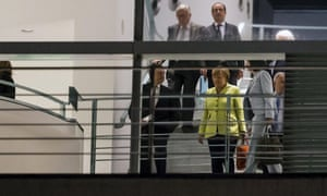 German Chancellor Angela Merkel (front R), European Central Bank (ECB) President Mario Draghi (L), French President Francois Hollande (top R) and European Commission President Jean-Claude Juncker (top L) walk through the chancellery in Berlin, Germany, June 1, 2015. REUTERS/Hannibal Hanschke