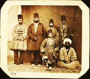 Muzaffar al-Din Mirza (Muzaffar al-Din Shah Qajar 1853-1907) accompanied by his entourage. Prince Muzaffar Mirza's high-ranking African slave (khajeh) is standing on his right, possibly in Tabriz, Iran, 1880s.