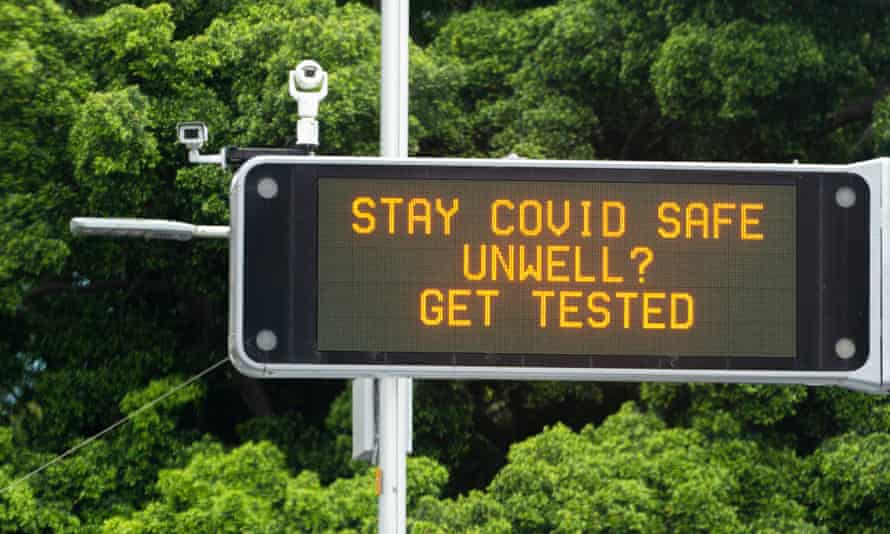 A Covid-safe sign is displayed in Sydney's CBD on Monday as the northern beaches cluster spread. A record 38,578 Sydneysiders were tested for coronavirus on Sunday.