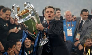 Inter's manager Jose Mourinho holds the trophy following their 2010 Champions League final victory against Bayern Munich in Madrid