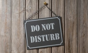Do Not Disturb Sign Hanging on Wooden Wall
