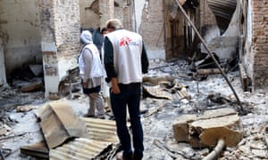 MSF staff stand in their destroyed hospital in Kunduz.
