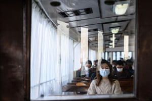 Passengers wear face masks as they travel via ferry in Hong Kong.
