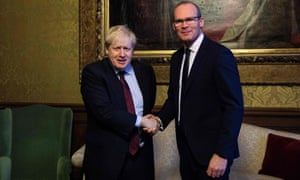 British foreign secretary Boris Johnson (L) greets the Irish deputy PM and foreign minister Simon Coveney (R) at the Foreign and Commonwealth Office in London.