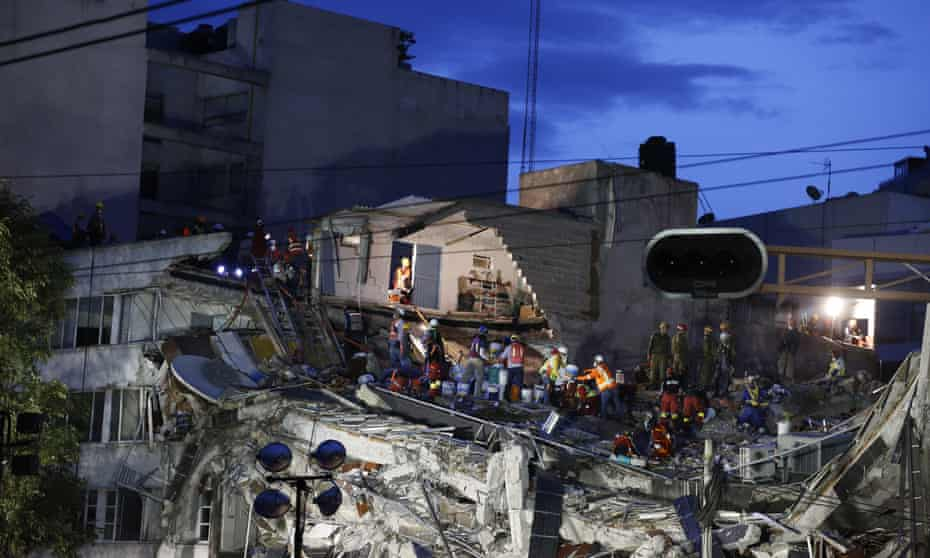 Rescuers at a collapsed building in Mexico City