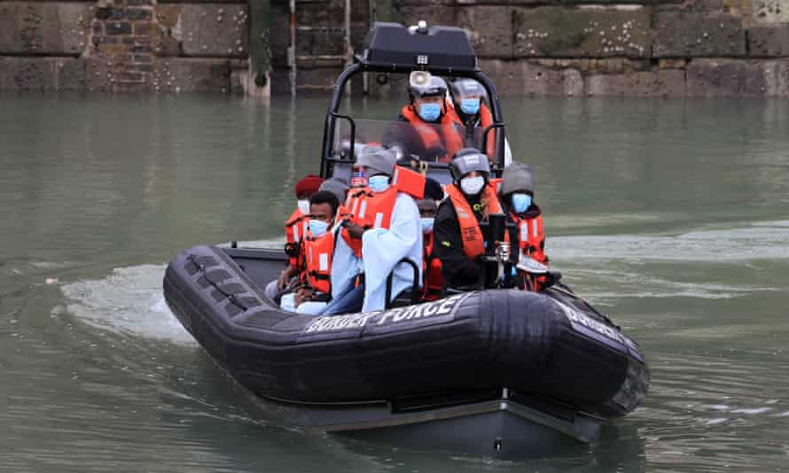 A group of people thought to be migrants are brought into Dover, Kent, by Border Force following a small boat incident in the Channel.