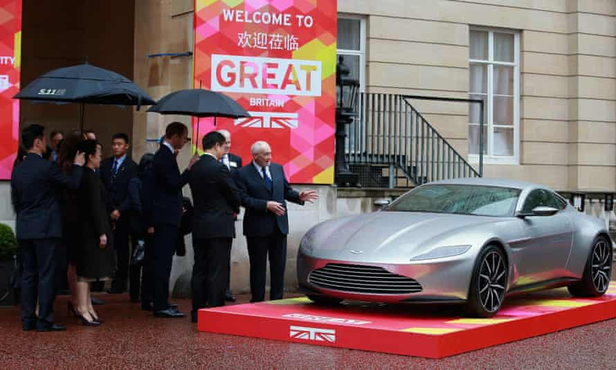 The Duke and Duchess of Cambridge view the Aston Martin DB10 with Xi Jinping and his wife, Peng Liyuan, at Lancaster House.