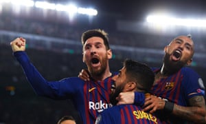 Lionel Messi of Barcelona celebrates with Luis Suarez and Arturo Vidal after scoring his side's second goal.
