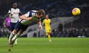 Harry Kane heads Tottenham in front.