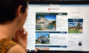 A woman looks at real estate advertising on an internet website in Brisbane, 6 January 2014