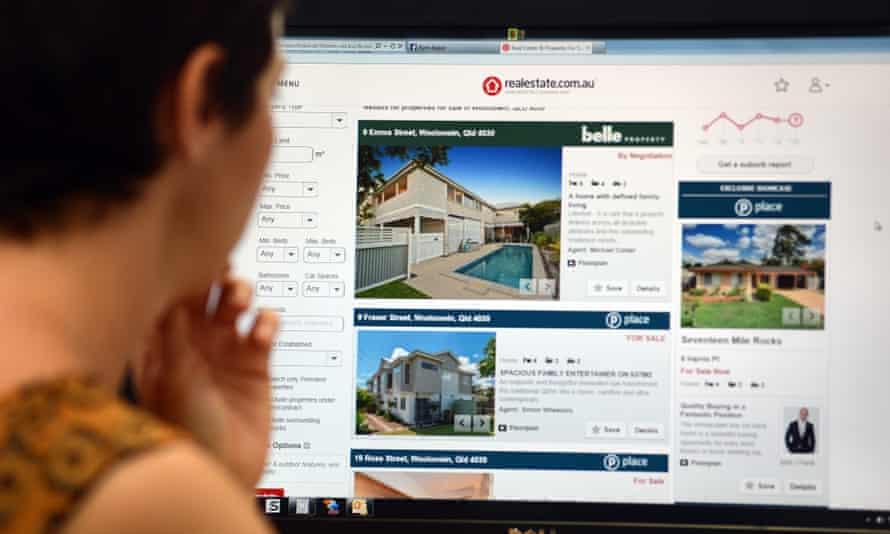 Woman looks at rental properties online.