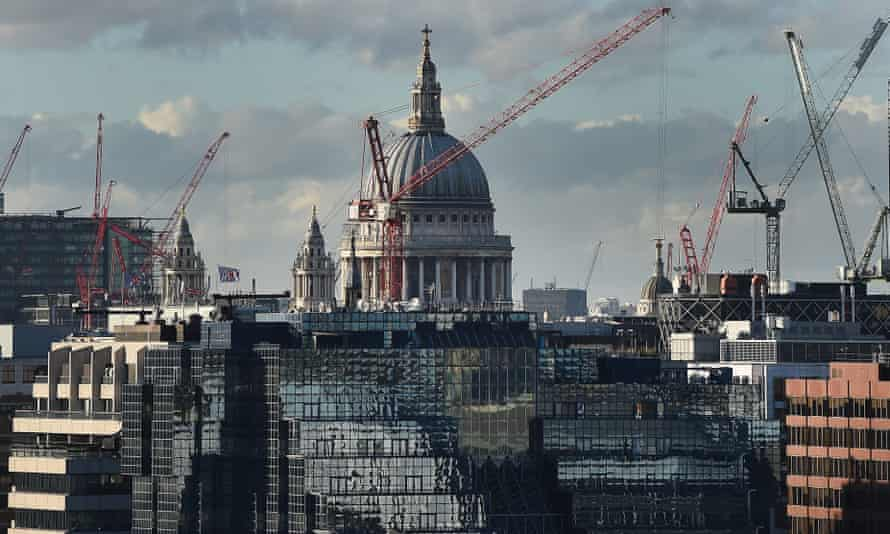 A crane towers over a building site in central London. The commercial property industry is seen as a bellwether for the economy.