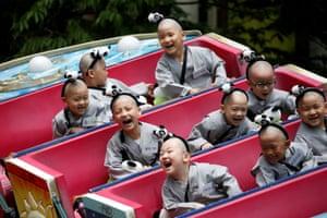 Yongin, South Korea: Novice monks enjoy a ride at the Everland amusement park