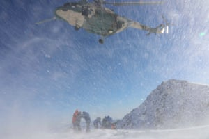 A helicopter rescues trapped climbers in Changji, China