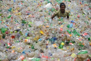 A woman sorts plastic bottles at a warehouse in Jalandhar, India