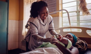 Jemima Makau, a midwife in Kenya,  with patient and newborn baby