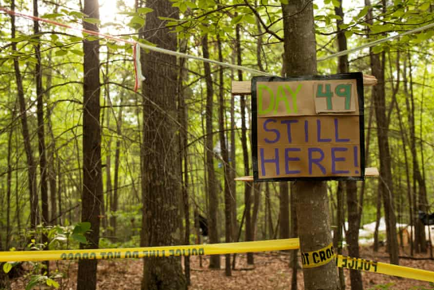 """A sign counts the days of protest, with police tape keeping the support camp 150 feet from the monopod to prevent food or water being given to """"Nutty""""."""