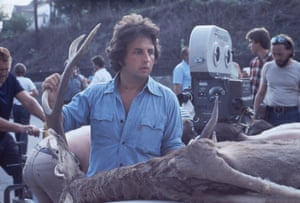 """Michael Cimino ensures the felled deer is strapped securely to the car driven by Michael Vronsky (Robert De Niro) Robert De Niro: """"I thought the script was really terrific in discovering the effects of war and how guys return. Michael had worked a lot on the script and had great ideas. He was very passionate.""""One Shot: The Making of The Deer Hunter by Jay Glennie is published on 11 December. All photographs: StudioCanal"""