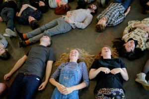 Participants lie on the floor during a 'laughter workshop' led by experimental musician Laraaji, at Cafe Oto in Dalston, London.