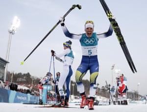 Sweden's Charlotte Kalla celebrates after winning the gold medal in the women's cross country 7.5km + 7.5km skiathlon.