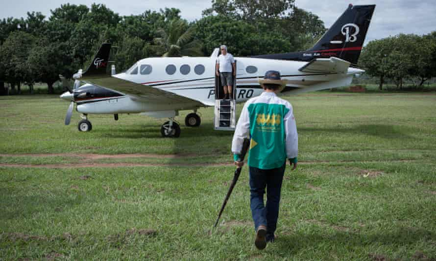 One of the sons of Ronaldo Rodrigues da Cunha, entering their private plane before living the farm. The boys are the fourth generation of farmers in their family.