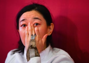 China's Sun Yiwen cries after got injured during her match against South Korea's Choi Injeong in the women's team epee semi-final bout