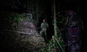 The elite Cacciatori unit during a night mission in the Calabrian mountains.