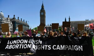 Activists protest outside parliament in London