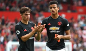 United's Daniel James (left) and Mason Greenwood look cheesed off as they applaud fans after the final whistle.