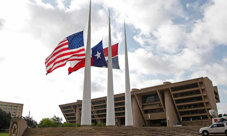 Five Police Officers Killed During Anti-Police Brutality March In DallasDALLAS, TX - JULY 8: Flags fly at half mast at Dallas City Hall following the fatal shootings of five police officers on July 8, 2016 in Dallas, Texas. Micah Xavier Johnson has been identified as the suspected sniper in the fatal shooting of five police officers, and injuring seven more at a Black Lives Matter demonstration held on July 7, 2016 in Dallas, Texas. (Photo by Stewart F. House/Getty Images)