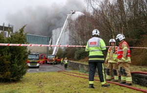Firefighters at the scene of Ocado robotic warehouse in Andover, Hampshire.