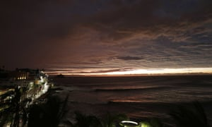 The sun sets, as Hurricane Willa makes landfall, in Mazatlan, Mexico, on Tuesday.