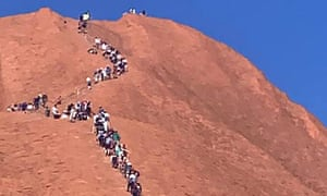 Huge numbers of people climb Uluru in a rush before climbing is closed for good in October