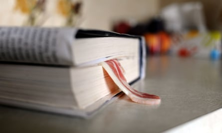 Unsavoury behaviour … rasher of bacon being used as a bookmark.