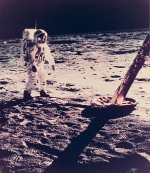 Neil Armstrong walks near the gold foil wrapped foot of the lunar landing module