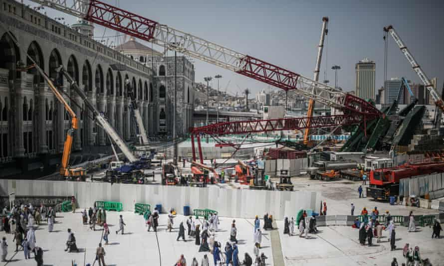 Muslim pilgrims walk past a collapsed crane that killed more than 100 people at the Grand Mosque in Mecca, Saudi Arabia.