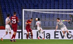 Edin Dzeko heads the first goal for Roma.