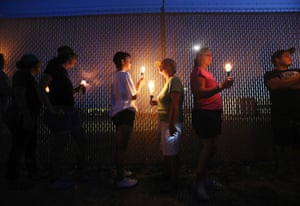 Clint, US. Activists hold a candlelight vigil next to the perimeter fence to a US border patrol station in Texas where migrant children have been reportedly held in squalid conditions