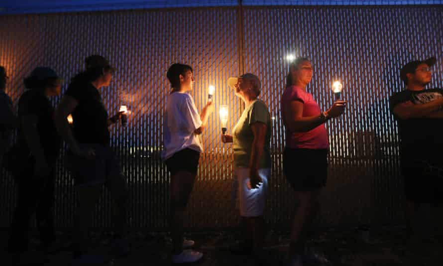Activists hold a candlelight vigil at the perimeter fence securing a US Border Patrol station in Clint, Texas.