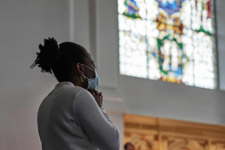 A member of the congregation in prayer at St John at Hackney church, east London