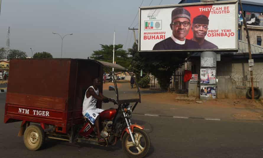 In Abuja the faces of president Mohammadu Buhari and vice-president Yemi Osinbajo stare down from a billboard as Nigeria prepared for general elections in February 2019.