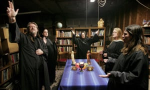 Wicca religion practitioners (l-r) Don Lewis, Krystal High-Correll, and Virgina Powell and student Ashleigh Powell and Cathy Smith participate in a Wiccan Lunar ritual in the temple at the Witch School in Hoopeston, Illinois.