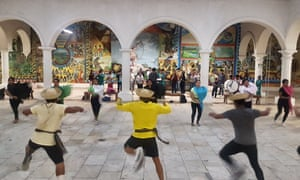 Dance troop (including Yalitza's brothers) rehearsing inside the Casa de Cultura with the band for this year's indigenous dance and cultural festival, the Guelaguetza.