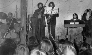 Photo by: Sovfoto/Universal Images Group via Getty Images. Plastic People of the Universe performing at Hradecek Cottage that belonged to playwright Vaclav Havel in 1977.